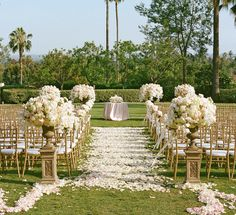 Beautiful ceremony flowers.The big ones might be a bit much, but the aisle decoration and smaller floral decorations are beautiful!