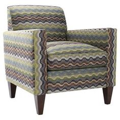 """Arm chair with multicolor zigzag upholstery and tapered legs. Made in the USA.   Product: ChairConstruction Material: Wood and fabricColor: MultiFeatures: Tapered legsMade in the USADimensions: 33"""" H x 32.5"""" W x 29.5"""" D"""