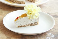 Pacifica Cake - Raw coconut and walnut base with a creamy pineapple, banana and coconut filling dusted with freeze dried passionfruit (flavour explosion) and studded with bright flowers    Raw * Gluten free * Dairy free * Paleo * Refined sugar free  Ascension Kitchen x
