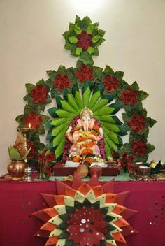 Ganpati decoration use spoon for outside on top of foam for Artificial flower decoration for ganpati