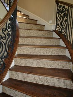 Love the tile/hardwood combo.  Looks easy to clean, no more steaming the stairs.