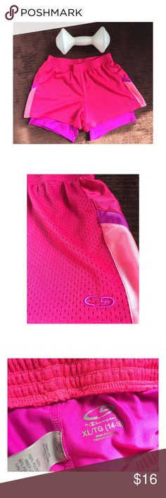 Champion Pink Shorts w Built in Compression shorts Great Condition. Size 14/16 in kids equivalent to a women's small! Champion Shorts