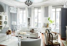 gray wall color with white in room with lots of light with pops of color. Different light fixture