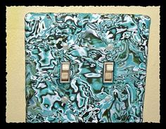 """Polymer clay switchplate tutorial - this one shows the mokume gane technique for a """"marblized"""" effect."""