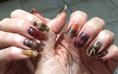 Turkey feathers manicure for Thanksgiving.  i do not think so. something about it just looks kinda dirty.