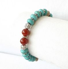 Enjoy the colors of the southwest on your arm each time you accessorize with this sensational turquoise howlite, genuine carnelian and silver