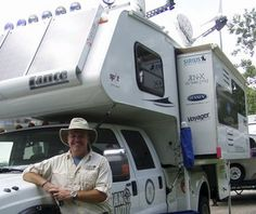 A Ford F-350 topped with a Lance camper converted into an ecofriendly vehicle. The camping RV didn't need gas after the modifications, as it was made to run on clean biodiesel and harness solar and wind energy to power an air conditioner, microwave, refrigerator and television.