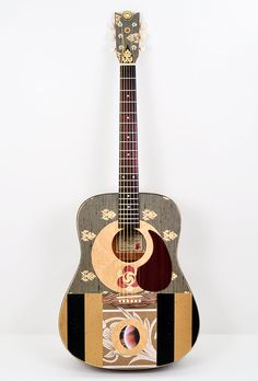 Hey, I found this really awesome Etsy listing at https://www.etsy.com/listing/94687098/acoustic-guitar-modified-saturn-calling