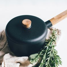 Product styling and photography of Eva Solo - Nordic Kitchen saucepan, styled with linen cloth and rosemary for Coolfoodstuff