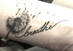 Breathe...my tattoo reminds me to breathe through the tough stuff. The dandelion represents the cycle of life, whether it be human life, the life of a relationship or situation, everything has its cycle & nothing is permanent...except for tattoos.