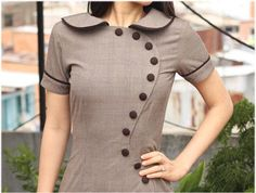 June Dress, Peter Pan Collar, Chic Anthony designed this perfect frock w/ classic style & a modern take on buttons. A classic collar joined with a modern half moon of buttons swinging their way to the top. Very stylish & unique Salwar Neck Designs, Kurta Neck Design, Neck Designs For Suits, Sleeves Designs For Dresses, Neckline Designs, Kurta Designs Women, Blouse Neck Designs, Kurti Sleeves Design, Kurti Designs Party Wear