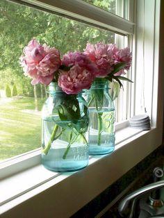 Love peonies or dahlias in mason jars...mom has a ton of mason jars!