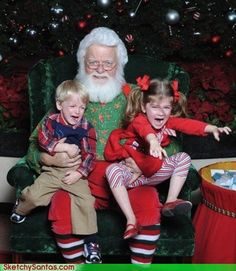 #22 Kids Who Are Totally Over Taking Their Photo With Santa #8 - These two kids who are determined to test the limits of Santa's power grip...And by the look on his face, he is ready for the challenge