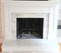 Fireplace makeover | tiling over a brick hearth with marble herringbone | www.shineyourlightblog.com