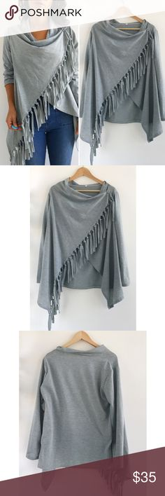 """Gray Fringe Sweater Gray Fringe Sweater! Excellent condition. Draped neck, buttons on shoulder. Fringe hem. Material tag has been removed inside. Length31"""" sleeve-23"""" size large. Sweaters"""