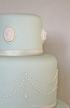 Cameo Wedding Cake :: pride & prejudice wedding inspiration. I would want this to be in a cream instead of light blue.