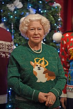 A wax figure of Queen Elizabeth II wears a Christmas jumpers in Madame Tussauds, London, to raise awareness of Save the Children. (Photo by Victoria Jones/PA Images via Getty Images)