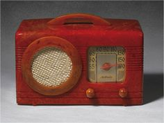 ". By far, the most desirable ""Circle Grille"" catalin radio, highlighted by the brilliantly marbled tomato red cabinet and butterscotch speaker bezel, handle, and knobs."