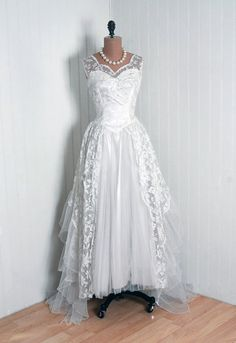 Couture Wedding Dress, Alfred Angelo Originals: 1950's, Chantilly lace and pleated net/tulle, sheer illusion beaded sleeveless bodice, tiered ruffled train.