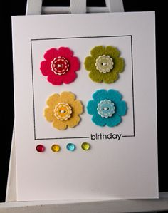 handmade card from Michelle's Crafting Corner: Paper Dolls Challenge #36 ... clean and simple design ... bright and pretty color with lots of white space ... luv the die cut felt flowers with created buttons and jelly dots in the the same colors ... great card!!