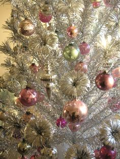 Vintage aluminum Christmas tree. I really like the colors they used. I need to get mine out and use it this year