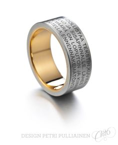 Laser engraved stainless steel ring with 750 yellow gold. Photo Teemu Töyrylä.