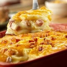 This tempting potato dish features thinly sliced potatoes layered with sliced onion, diced cooked ham and a creamy sauce featuring Campbell's(R) Condensed Cream of Celery Soup and Campbell's(R) Chicken Gravy, then topped with shredded Cheddar cheese and baked until the potatoes are tender and the cheese melts.