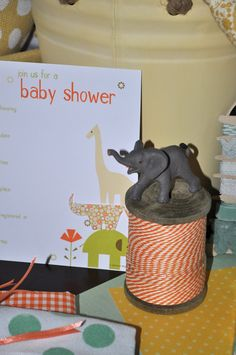 Invites from Target. Spool of thread from Hobby Lobby, mini elephant from Michaels. Thread Spools, Hobby Lobby, Paper Shopping Bag, Jr, Safari, Elephant, Target, Baby Shower, Organic