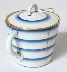 Gio Ponti (1891-1979), Italian / art deco teapot, decorated w/ blue and bands w/ gold rim and trim and hand-painted stylized gold bows and arrows, made by Richard Ginori, c. 1933, porcelain, Italy