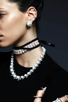 pearl ear cuffs, pearl earrings, pearl and leather choker, pearl necklace and rings