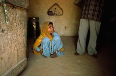 Modern slavery: A child bride cowers at her husband's feet - from Guardian News