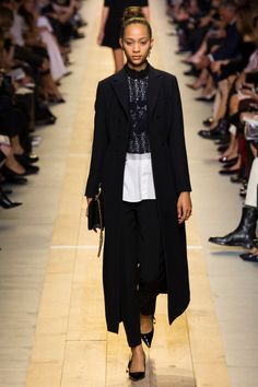 Dior Spring 2017: Model walks the runway in black coat over lace top, white shirt and cigarette pants