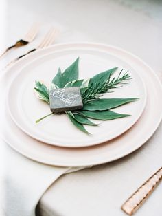 Foliage-filled place settings: http://www.stylemepretty.com/2016/02/22/30-must-haves-to-plan-the-ultimate-cool-girl-wedding/