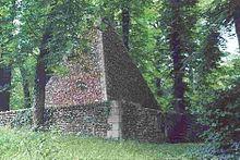 A pyramid folly, used as a hermitage in Slanderley.