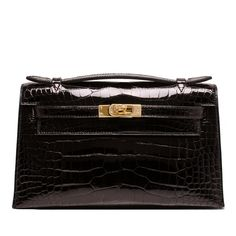Hermes Black Mini Kelly Pochette clutch of shiny alligator with gold hardware. AVAILABLE NOW For purchase inquiries, Please Contact: Email: info@madisonavenuecouture.com I Call (212) 207-4572 I WhatsApp (917) 391-2281 Direct Message on Instagram: @madisonavenuecouture Guaranteed 100% Authentic | Worldwide Shipping | Bank Transfer or Credit Card