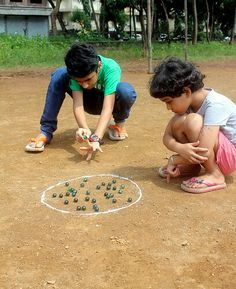 """In rural Bangladesh, wintertime is marble time. Children of all grades enjoy marble games.  """"  In tropical Bangladesh, wintertime is marble time. Children of all grades enjoy marble games."""