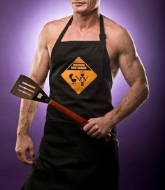 A funny groomsman gift that he'll love - our Warning: Men BBQing aprons are sturdy, comfortable and adjustable for size. Bulk discounts available. Perfect for a best man gift or groomsmen gifts! By Dell Cove Spice Co., Chicago, IL