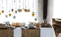 gold/silver/black balloons hanging in entryway with gold + silver stars tied to end
