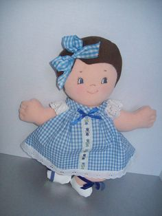 A 15 inch bright-eyed sweetie soft stuffed doll with smooth cloth hair.This pattern includes both dresses, hairbows,bloomers and shoes.  .Be sure to check out her BFF, best friend, Puddin Pie as shown in the picture.  **This is a pattern ONLY and not a completed doll**  Very fast and easy to make.  This is a PDF that can be downloaded immediately from PeekabooPorch on Etsy upon receipt of payment.