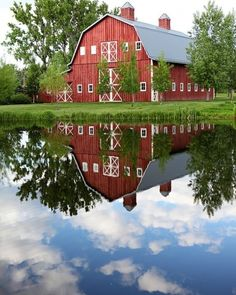 Beautiful red barn reflected in water