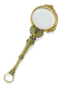 An Art Nouveau lorgnette composed of gold, enamel and sapphire, circa 1910.