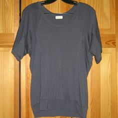 AG Adriano Goldschmied Gray Jersey Dolman Top This shirt is preloved but in very good condition. Looks hardly worn. It is a jersey style dolman short sleeve top in a Gray color. Made of 70% tender 30% cotton. Tag size is a medium but fits like an oversized M. AG Adriano Goldschmied Tops Tees - Short Sleeve