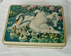 1957 vintage English biscuit tin swans and cygnets. £6.00, via Etsy.