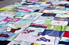 Aside from an AWESOME blog! this is a great idea. making a quilt from clothes your child has grown out of.