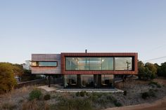 Built by Seeley Architects in Anglesea, Australia with date 2011. Images by Shannon McGrath. The Dame of Melba is a weekend holiday residence for a retired couple, set into a hillside overlooking the rugged Ang...