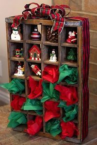 Coke crate turned holiday advent calendar.  Put little gifts or ornaments in each of the 24 cubbies.