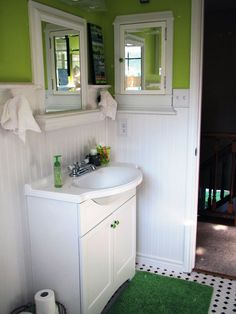 Smaller vanity: some storage (hang shelves on inside of cabinet drawers), much more than a pedestal sink (and with ugly plumbing bits hidden) but with much less visual weight than a full-width vanity
