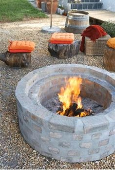How to build an outdoor fire pit. I love everything about this rustic scene. The wood stools, the cushions, the fire pit! Diy Fire Pit, Fire Pit Backyard, Fire Pits, Fire Pit Instructions, Outdoor Spaces, Outdoor Living, Outdoor Life, Parrilla Exterior, Fire Pit Furniture