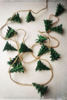 Evergreen Christmas Tree Origami Garland by EnduringVision on Etsy christmas garland Christmas Garland Rustic Evergreen Christmas Tree Decoration Decoration Christmas, Noel Christmas, Rustic Christmas, Winter Christmas, Christmas Ornaments, Holiday Decorations, Origami Christmas Tree, Diy Christmas Tree Garland, Homemade Christmas Decorations
