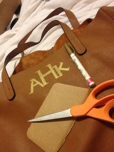 DIY Monogram Easy! I did this free write with a gold sharpie. Used a cut out cardboard as my ruler and monogrammed my real leather tote. This is my first time, not the best. But totally loving it!